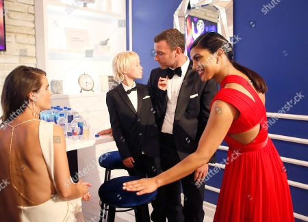 Keri Russell, from left, Alexander Pete Schreiber, Liev Schreiber, and Priyanka Chopra backstage at the 68th Primetime Emmy Awards in the Chase Sapphire Reserve Blue Room, at the Microsoft Theater in Los Angeles