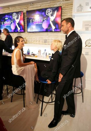 Keri Russell, from left, Alexander Pete Schreiber, and Liev Schreiber backstage at the 68th Primetime Emmy Awards in the Chase Sapphire Reserve Blue Room, at the Microsoft Theater in Los Angeles