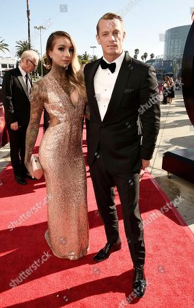 Joel Kinnaman, right, and Cleo Wattenstrom arrive at the 68th Primetime Emmy Awards, at the Microsoft Theater in Los Angeles