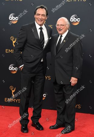 Jimmy Smits, left, and Dennis Franz pose in the press room at the 68th Primetime Emmy Awards, at the Microsoft Theater in Los Angeles