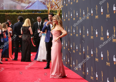 Louis Aguirre, left, and Debbie Matenopoulos arrive at the 68th Primetime Emmy Awards, at the Microsoft Theater in Los Angeles