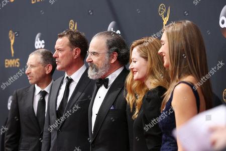 Mark Ivanir, from left, Sebastian Koch, Mandy Patinkin, Miranda Otto and Sarah Sokolovic arrive at the 68th Primetime Emmy Awards, at the Microsoft Theater in Los Angeles