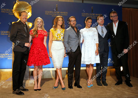 Executive producer Barry Adelman, from left, Miss Golden Globe Greer Grammer, Kate Beckinsale, Jeremy Piven, Paula Patton, Peter Krause and HFPA President Theo Kingma appear on stage at the 72nd annual Golden Globe Awards nominations announcement at the Beverly Hilton hotel, in Beverly Hills, Calif. The 72nd annual Golden Globe Awards will be held on Sunday, Jan. 11, 2015