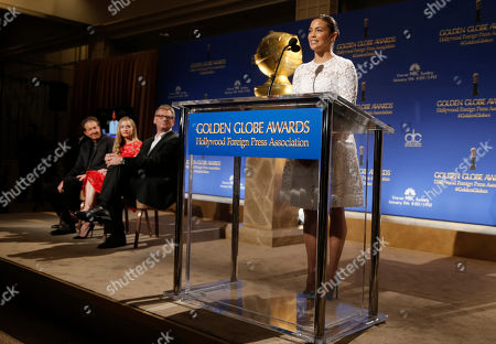 Paula Patton announces nominations for the 72nd annual Golden Globe Awards at the Beverly Hilton hotel, in Beverly Hills, Calif. The 72nd annual Golden Globe Awards will be held on Sunday, Jan. 11, 2015. Looking on from left are executive producer Barry Adelman, Miss Golden Globe Greer Grammer and HFPA President Theo Kingma