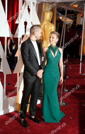 Romain Dauriac, left, and Scarlett Johansson arrives at the Oscars, at the Dolby Theatre in Los Angeles