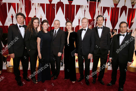 Hillel Roseman, from left, Yael Abecassis, Mihal Brezis, Oded Binnun, Sarah Adler, Ulrich Thomsen, Pablo Mehler, and Tom Shoval arrive at the Oscars, at the Dolby Theatre in Los Angeles