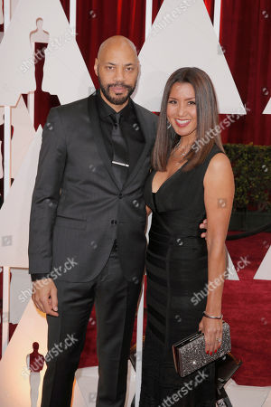 Stock Picture of John Ridley, left, and Gayle Yoshida arrive at the Oscars, at the Dolby Theatre in Los Angeles
