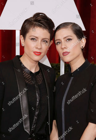 Tegan Rain Quin, left, and Sara Keirsten Quin arrive at the Oscars, at the Dolby Theatre in Los Angeles