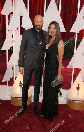 Stock Image of John Ridley, left, and Gayle Yoshida arrive at the Oscars, at the Dolby Theatre in Los Angeles