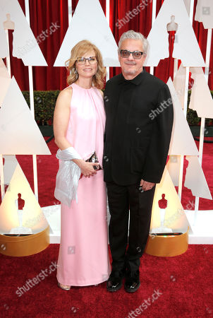 Anita Greenspan, left and Mark Mothersbaugh arrive at the Oscars, at the Dolby Theatre in Los Angeles