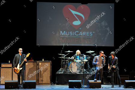 Honoree Chester Bennington, second from right, performs with, left, to right, Stone Temple Pilots' Robert DeLeo, Eric Kretz and Dean DeLeo at the 9th Annual MusicCares MAP Fund Benefit Concert at Club Nokia on in Los Angeles