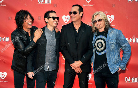 Honoree Chester Bennington, second from left, poses with, left to right, Stone Temple Pilots' Dean DeLeo, Robert DeLeo and Eric Kretz at the Ninth Annual MusicCares MAP Fund Benefit Concert at Club Nokia on in Los Angeles