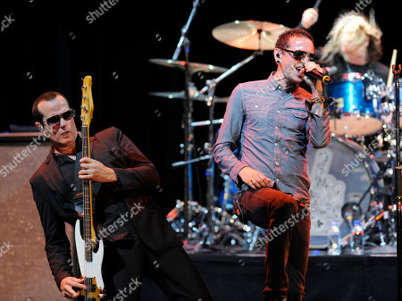 Honoree Chester Bennington, right, performs with Stone Temple PIlots' Robert DeLeo, left, and Eric Kretz at the Ninth Annual MusicCares MAP Fund Benefit Concert at Club Nokia on in Los Angeles