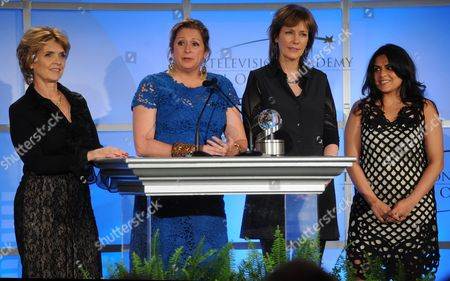 """Stock Photo of MAY 2: (L-R) Executive producers Gini Reticker, Abigail Disney, Pamela Hogan, and senior producer Nina Chaudry accept the Academy honor award for """"Women, War & Peace"""" onstage at the Academy of Television Arts & Sciences Presents """"The 5th Annual Television Academy Honors"""" at the Beverly Hills Hotel on in Beverly Hills, California"""