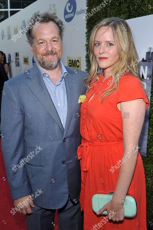 Stock Image of Actors David Costabile, left, and Eliza Baldi arrive to AMC's 'Low Winter Sun' premiere screening on in Los Angeles