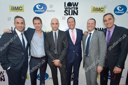 From left, head of creative affairs, Endemol Studios Jeremy Gold, writer/executive producer/show runner Chris Mundy, actor Mark Strong, president of AMC, Charlie Collier, CEO, Endemol Studios Philippe Maigret, and CEO, AMC networks Josh Sapan arrive to AMC's 'Low Winter Sun' premiere screening on in Los Angeles