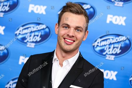 Season 14 runner up, Clark Beckham, poses in the press room at the American Idol XIV finale at the Dolby Theatre, in Los Angeles