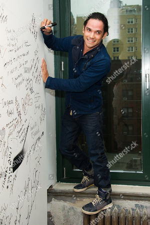 """Reece Ritchie signs the wall at AOL Studios after participating in AOL's BUILD Speaker Series to discuss his new film """"Desert Dancer"""", in New York"""