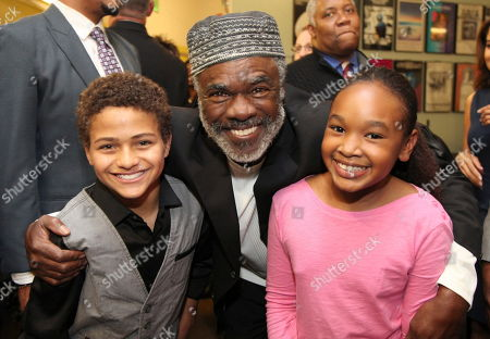 """From left, cast members Nathaniel James Potvin, Glynn Turman and Skye Barrett pose backstage after the opening night performance of August Wilson's """"Joe Turner's Come and Gone"""" at CTG/Mark Taper Forum, in Los Angeles, Calif"""