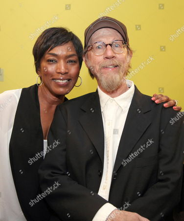 """Stock Image of From left, actress Angela Bassett and cast member Raynor Scheine pose backstage after the opening night performance of August Wilson's """"Joe Turner's Come and Gone"""" at CTG/Mark Taper Forum, in Los Angeles, Calif"""