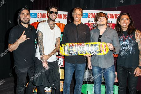 "Skateboarder Tony Hawk, center, poses with members of the group ""Of Mice & Men,"" from left, Valentino Arteaga, Austin Carlile, Aaron Pauley, and Phil Manansala at the Boards and Bands Auction press conference held at The London West Hollywood, in West Hollywood, Calif"