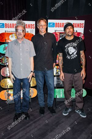 From left, musician, Mark Mothersbaugh, skateboarder Tony Hawk, and musician Ben Harper attend the Boards and Bands Auction press conference held at The London West Hollywood on in West Hollywood, Calif