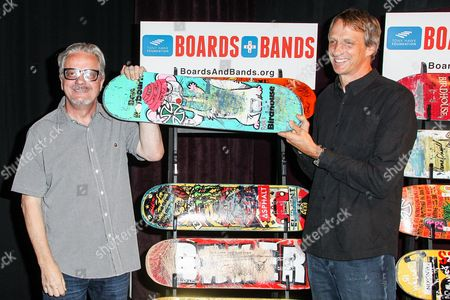 Musician, Mark Mothersbaugh, left and skateboarder Tony Hawk attend the Boards and Bands Auction press conference held at The London West Hollywood on in West Hollywood, Calif