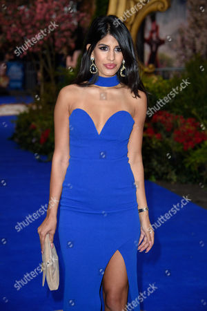 Stock Photo of Jasmine Walia poses for photographers upon arrival at the European premiere of the film 'Alice Through The Looking Glass' at a central London cinema, London
