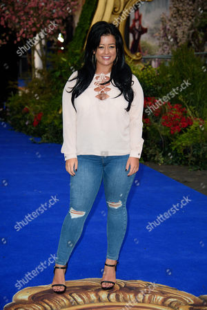 Lauren Murray poses for photographers upon arrival at the European premiere of the film 'Alice Through The Looking Glass' at a central London cinema, London