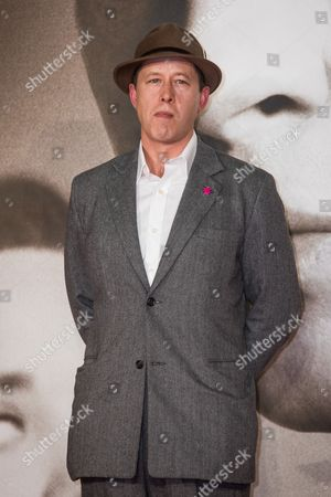 Daniel Betts poses for photographers upon arrival at the premiere of the film 'Allied' in London