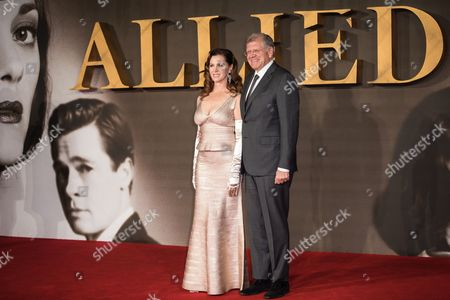 Leslie Harter Zemeckis and Robert Zemeckis pose for photographers upon arrival at the premiere of the film 'Allied' in London