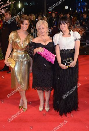 """Stock Picture of Sarah Owen, Alison Owen and Lily Allen arrive at the 57th BFI London Film Festival Closing Night and """"Saving Mr Banks"""" screening at the Odeon West End,, in London"""