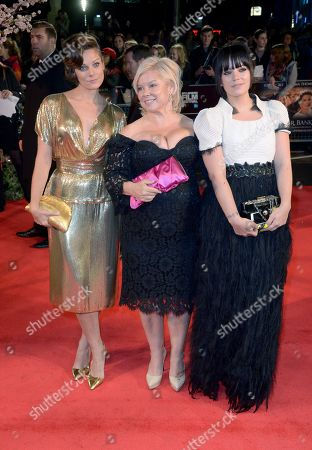 """Stock Photo of Sarah Owen, Alison Owen and Lily Allen arrive at the 57th BFI London Film Festival Closing Night and """"Saving Mr Banks"""" screening at the Odeon West End,, in London"""