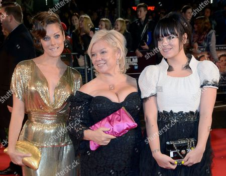 """Sarah Owen, Alison Owen and Lily Allen arrive at the 57th BFI London Film Festival Closing Night and """"Saving Mr Banks"""" screening at the Odeon West End,, in London"""