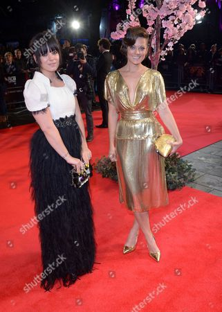 """Lilly Allen and Sarah Owen British singer Lily Allen and her sister Sarah Owen arrive at the 57th BFI London Film Festival Closing Night and """"Saving Mr Banks"""" screening at the Odeon West End,, in London"""