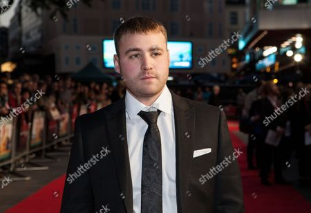 Actor Emory Cohen poses for photographers upon arrival at the Premiere of the film Brooklyn, showing as part of the London Film Festival, in central London