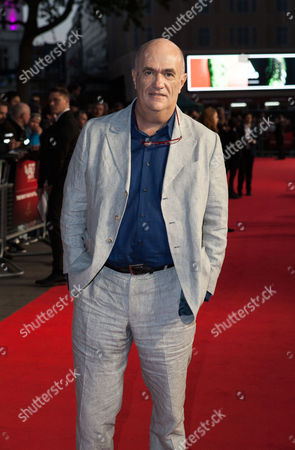 Writer Colm Toibin poses for photographers upon arrival at the Premiere of the film Brooklyn, showing as part of the London Film Festival, in central London