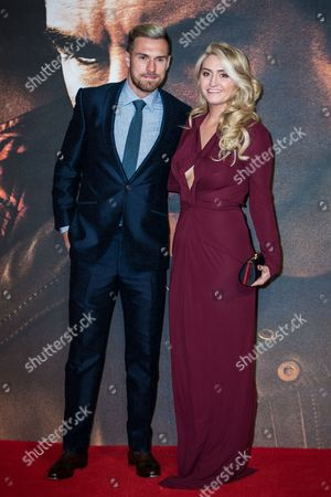 Aaron Ramsey and Colleen Ramsey pose for photographers upon arrival at the premiere of the film 'Jack Reacher: Never Go Back' in London