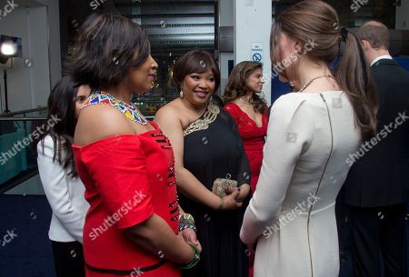 The Duchess of Cambridge meets Zenani Mandela, left and Zindzi Mandela, ahead of the UK Premiere of the Long Walk to Freedom, a film based on the South African President Nelson Mandela's autobiography of the same name, to the Odeon cinema in Leicester Square, central London