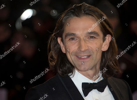 Director Justin Chadwick arrives for the UK Premiere of the Long Walk to Freedom, a film based on the South African President Nelson Mandela's autobiography of the same name, to the Odeon cinema in Leicester Square, central London