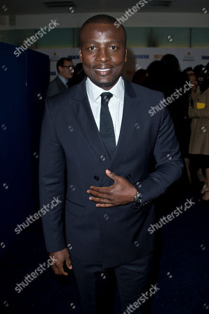 South African actor Tony Kgoroge arrives for the UK Premiere of the Long Walk to Freedom, a film based on the South African President Nelson Mandela's autobiography of the same name, to the Odeon cinema in Leicester Square, central London