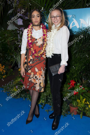 Stock Image of Sophie Simnett, right and Jade Alleyne pose for photographers upon arrival at a UK Gala screening of the film 'Moana' in London