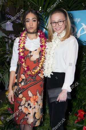 Sophie Simnett, right and Jade Alleyne pose for photographers upon arrival at a UK Gala screening of the film 'Moana' in London