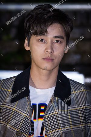Stock Photo of Li Yifeng poses for photographers upon arrival at the Stella McCartney collection presentation, in London