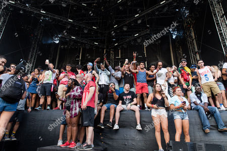 Fans are on stage as Jay Electronica performs at Made In America Festival, in Philadelphia