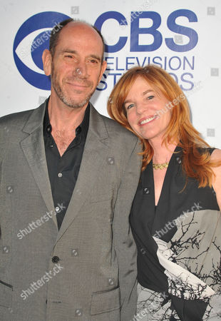Stock Photo of Miguel Ferrer, at left, and Lori Weintraub arrives at CBS Television Studios Summer Soiree at The London Hotel on in Los Angeles
