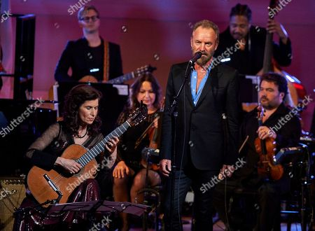 Stock Image of Sharon Isbin and Sting performing at the David Lynch Foundation Benefit Concert at Carnegie Hall on Wed., in New York