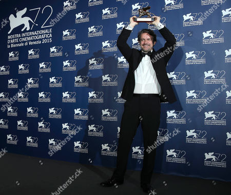Director Lorenzo Vigas poses with his Golden Lion for best movie for his 'Desde Alla' (From afar) at the 72nd edition of the Venice Film Festival in Venice, Italy