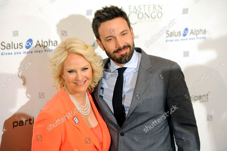 Honoree Ben Affleck, right, poses with Gala Chair Cindy Hensley McCain at the Cinema For Peace Foundation's 2013 Gala for Humanity at the Beverly Hills Hotel, in Beverly Hills, Calif