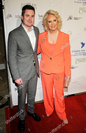 Gala Chair Cindy Hensley McCain poses with her son Jimmy at the Cinema For Peace Foundation's 2013 Gala for Humanity at the Beverly Hills Hotel, in Beverly Hills, Calif